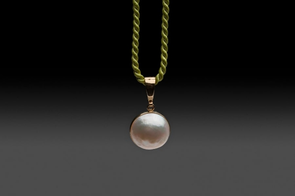 WHITE MABE PEARL PENDANT ON SILK CORD